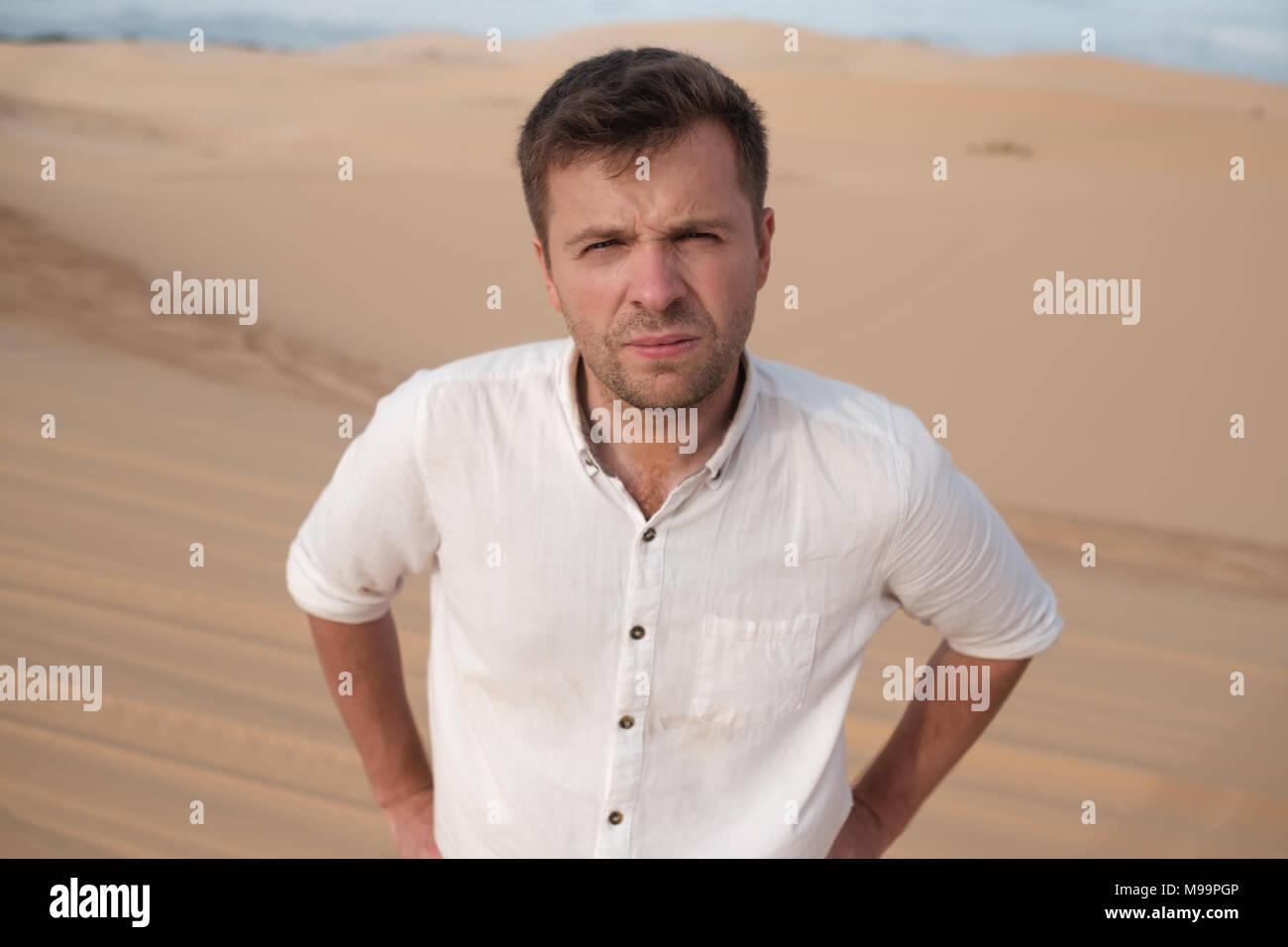 Serious man looking at camera. - Stock Image