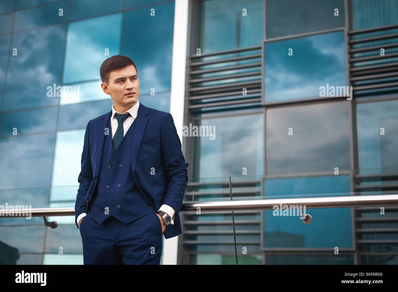 Thoughtfull groom in a suit waiting for the bride - Stock Image
