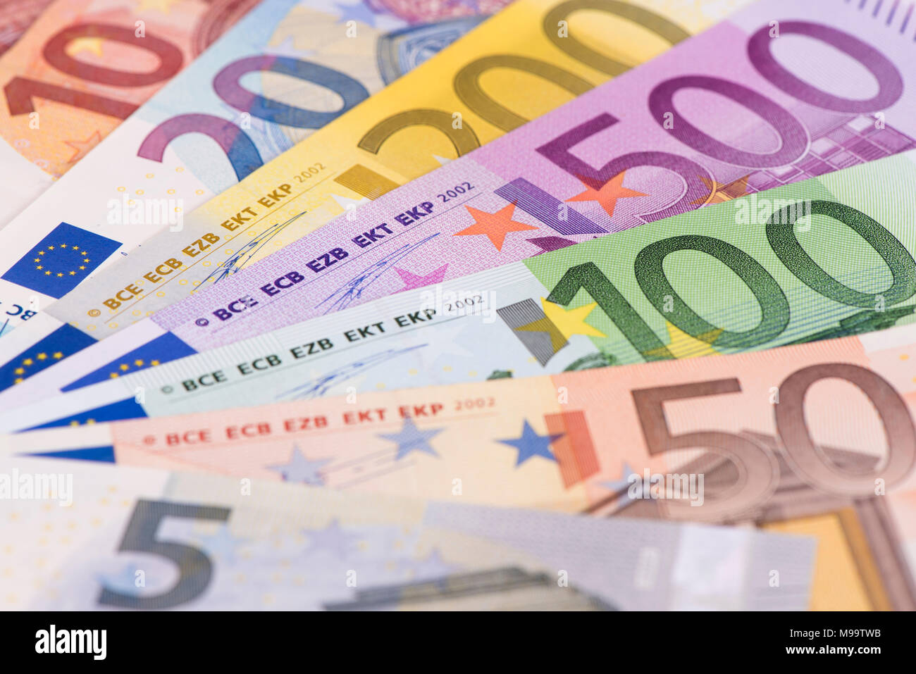 group of many Euro banknotes laying on table - Stock Image