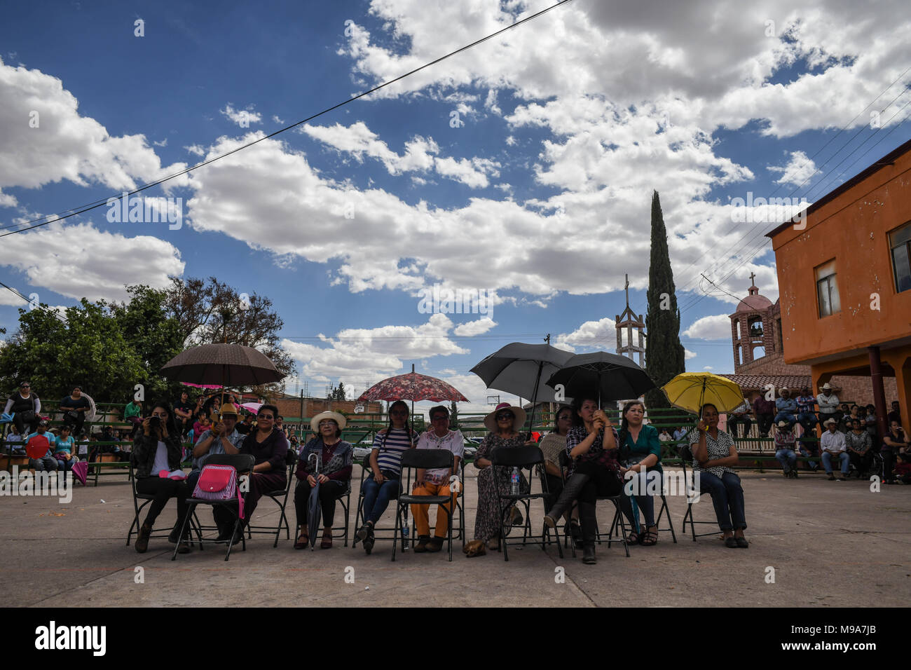 Colonia Gonzalez Ortega, Zacatecas, Mexico. 23rd Mar, 2018. Farmers listen to officials Friday as residents of rural Colonia Gonzalez Ortega, Zacatecas, rallied along with 20 other towns to become an independent municipality breaking out from Sombrerete in the hope of improving services such as water and infrastructure which are currently worse than some places in Sub-Saharan Africa. The central Mexican town is in many ways the quintessential Revolutionary Mexican town-- founded in 1928 -- and evolved into the ''grain silo'' of the country. It has suffered over the years due to half its pop - Stock Image
