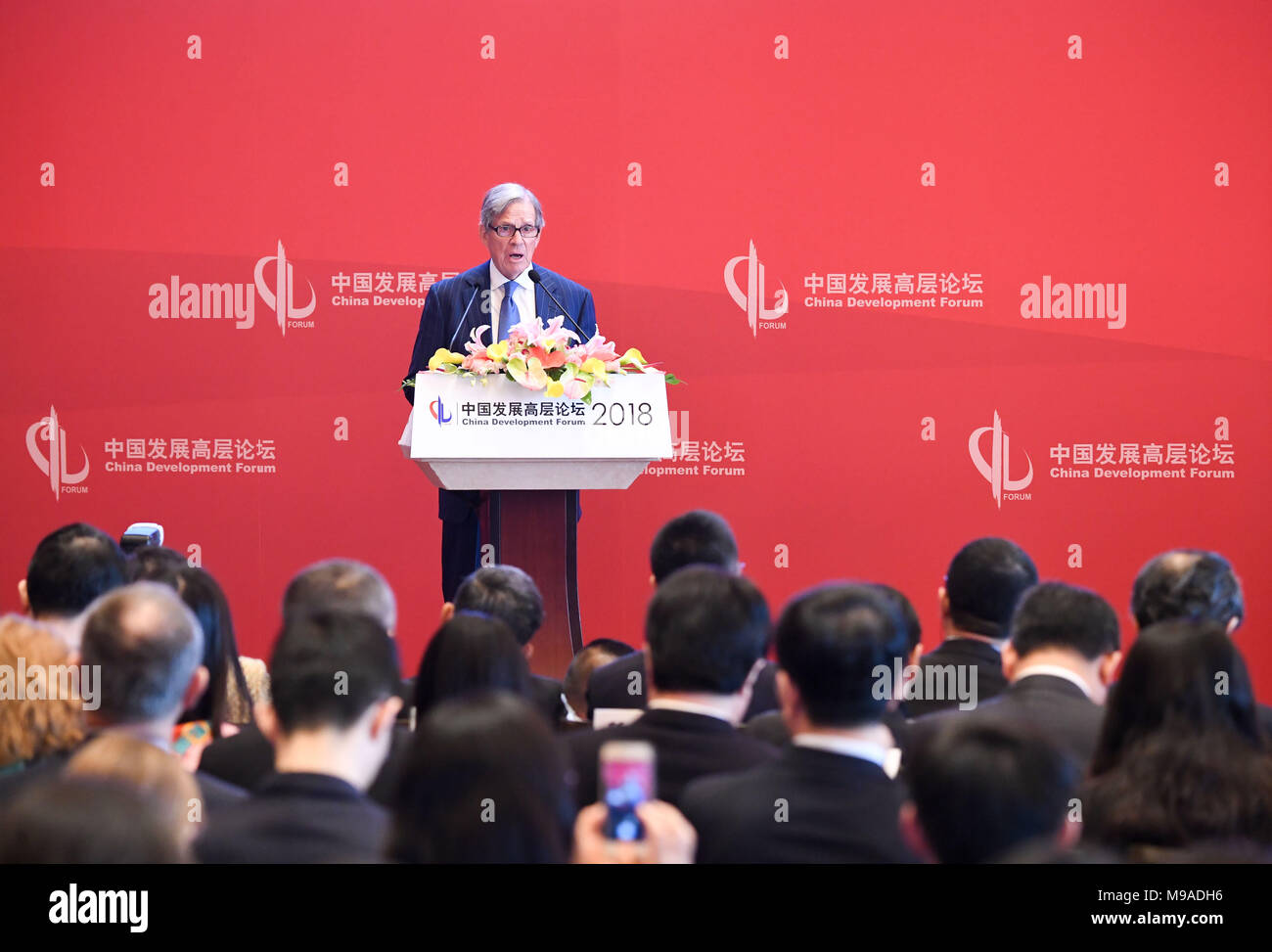 Beijing, China. 24th Mar, 2018. Peter Grauer, chairman of Bloomberg L.P., speaks at the China Development Forum (CDF) Economic Summit in Beijing, capital of China, March 24, 2018. China Development Forum, hosted by the Development Research Center of the State Council, is being held from March 24 to 26. Credit: Chen Yehua/Xinhua/Alamy Live News Stock Photo