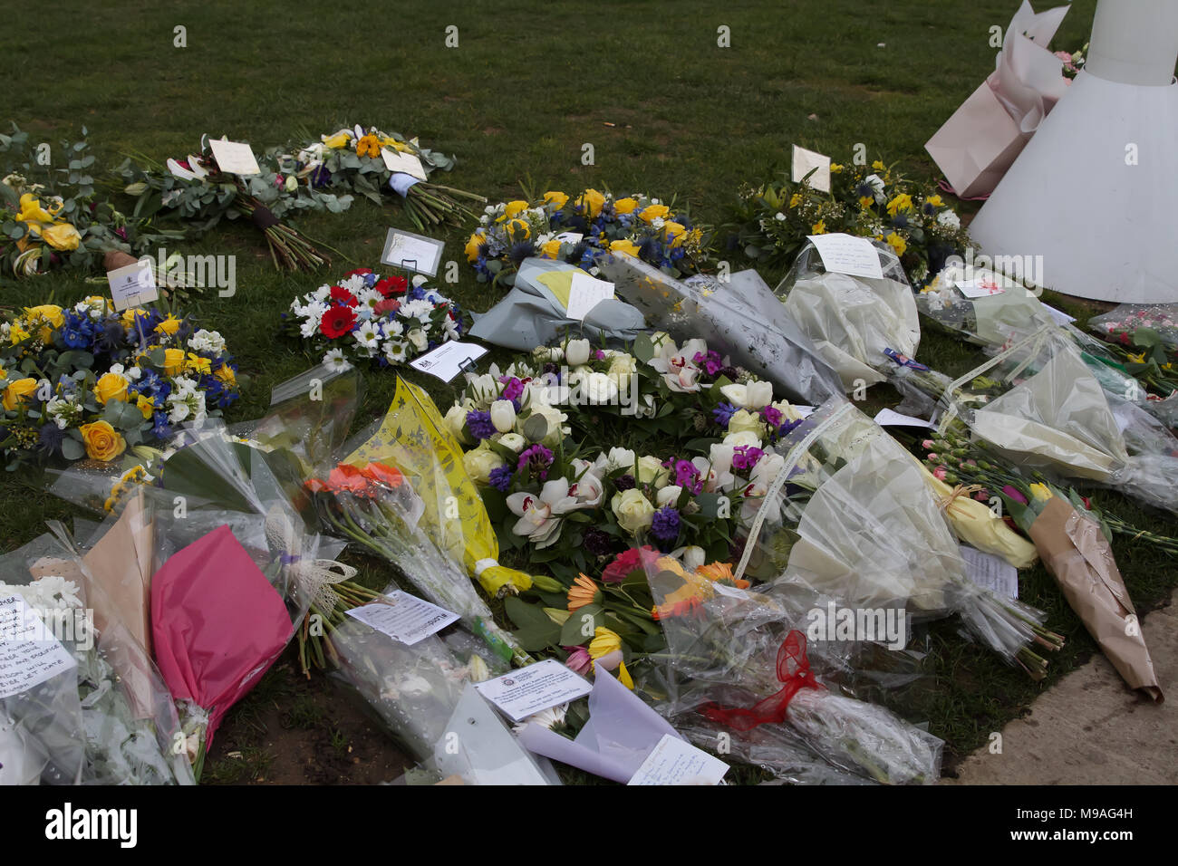 London,UK,24th March 2018, Flowers and tributes left on Parliament Square to remember the people who lost their lives a year ago on Westminster bridge and in front of the Houses of Parliament. Credit Keith Larby/Alamy Live News - Stock Image