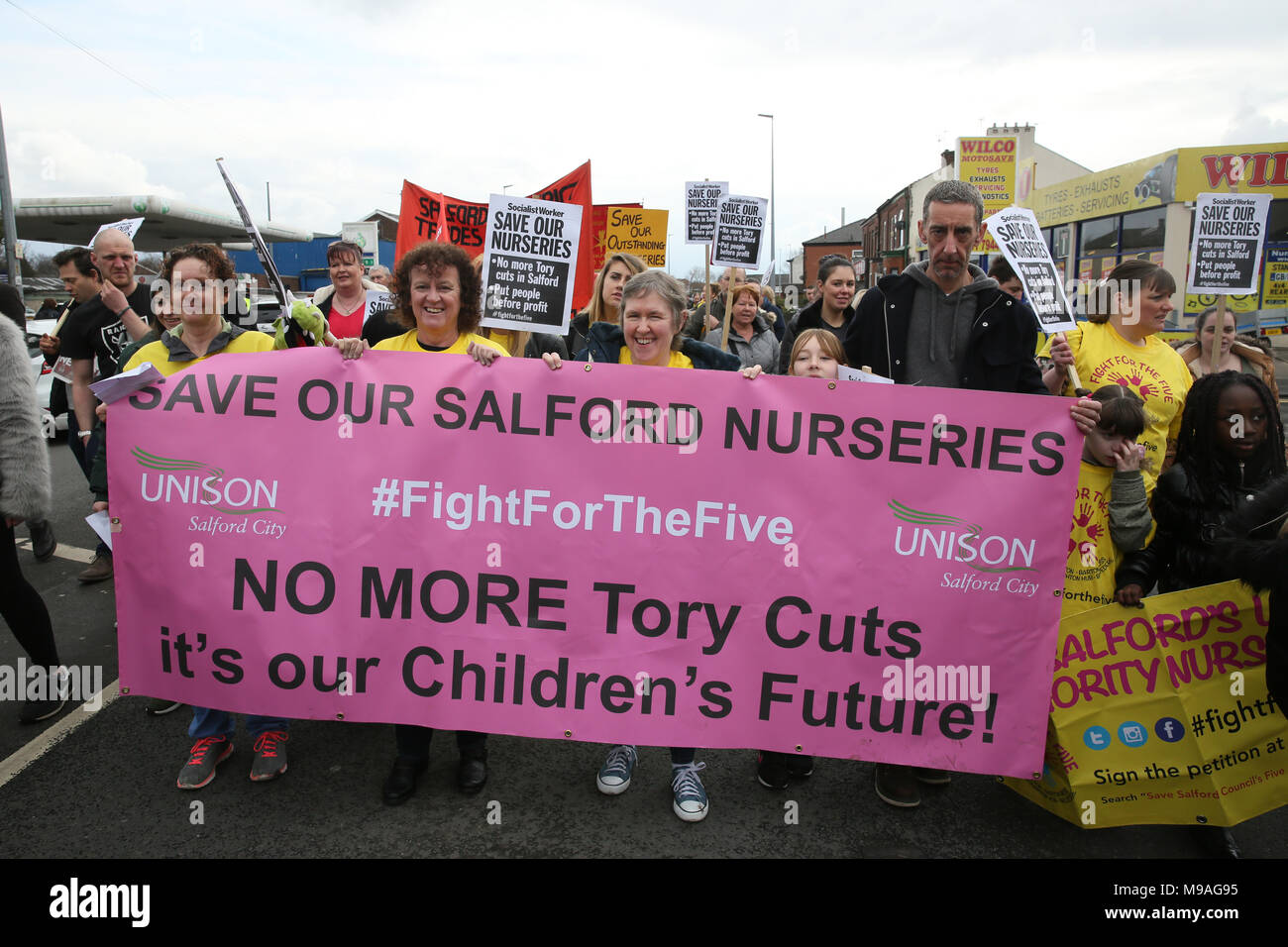 Salford, UK. 24th March, 2018. Unison members march to save Salford local authority nurseries which had been under threat of closure.  The Mayor has confirmed the status of the nurseries for the next 12 months and that he has agreed to put another £1.5m of Council money into them for that period Swinton, Salford, 24th March, 2018 (C)Barbara Cook/Alamy Live News Stock Photo