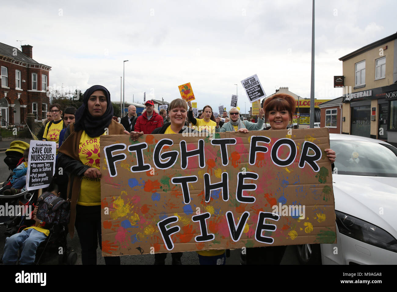 Salford, UK. 24th March, 2018. Families march to save Salford local authority nurseries which had been under threat of closure.  The Mayor has confirmed the status of the nurseries for the next 12 months and that he has agreed to put another £1.5m of Council money into them for that period Swinton, Salford, 24th March, 2018 (C)Barbara Cook/Alamy Live News Stock Photo