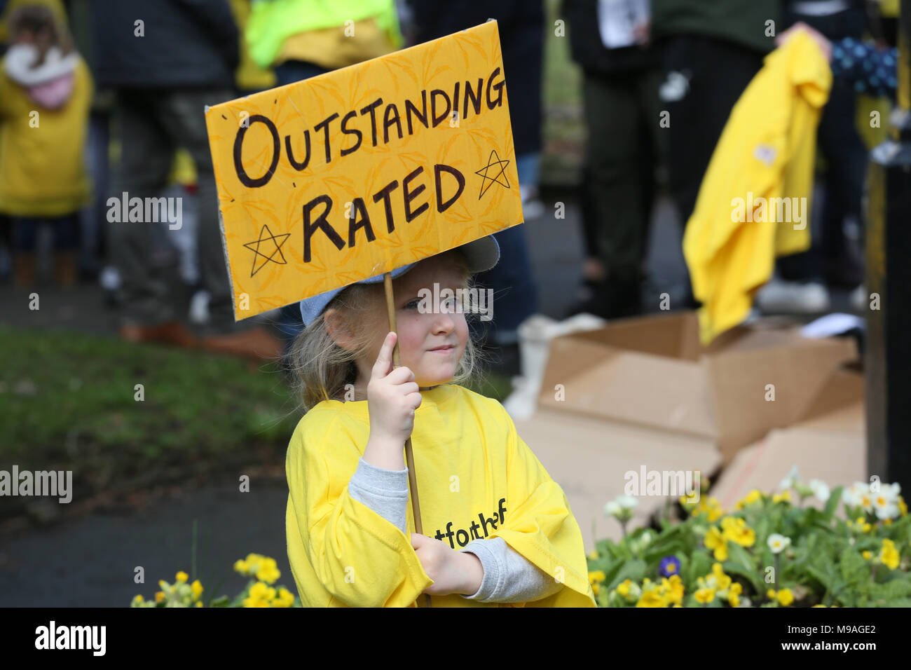 """Salford, UK. 24th March, 2018. A girl holding a sign which reads """"Outstanding rated"""" referring to the schools threatened with closure, Swinton, Salford, 24th March, 2018 (C)Barbara Cook/Alamy Live News Stock Photo"""