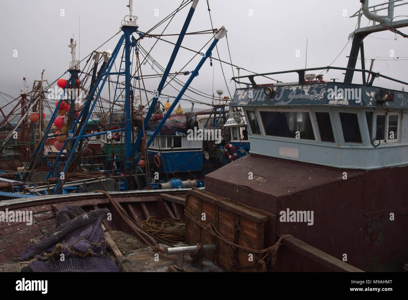 Cluster of fishing vessels moored together. - Stock Image