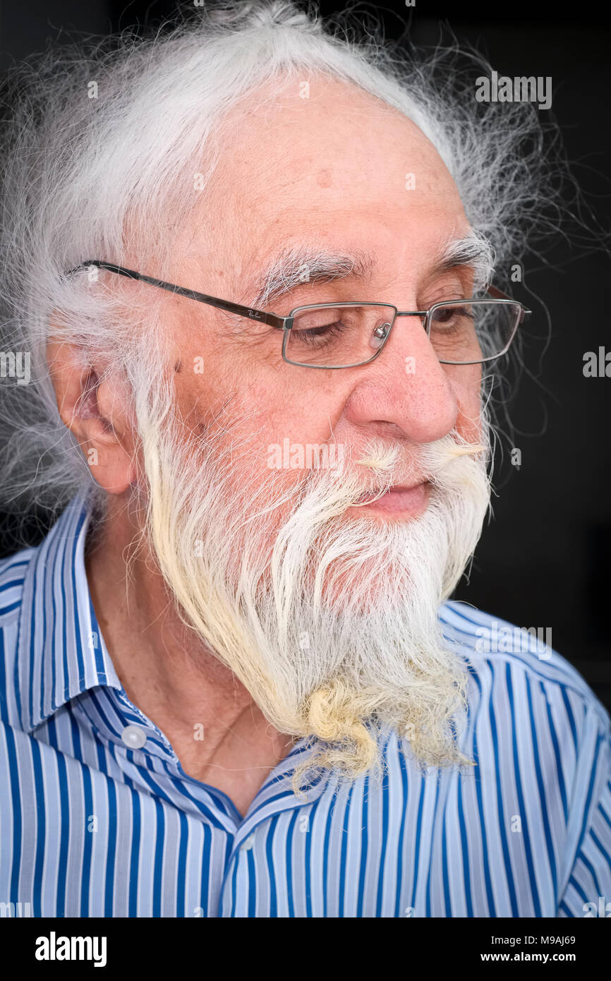 Portrait of Senior Sikh Indian Man relaxing at home without Turban - Stock Image