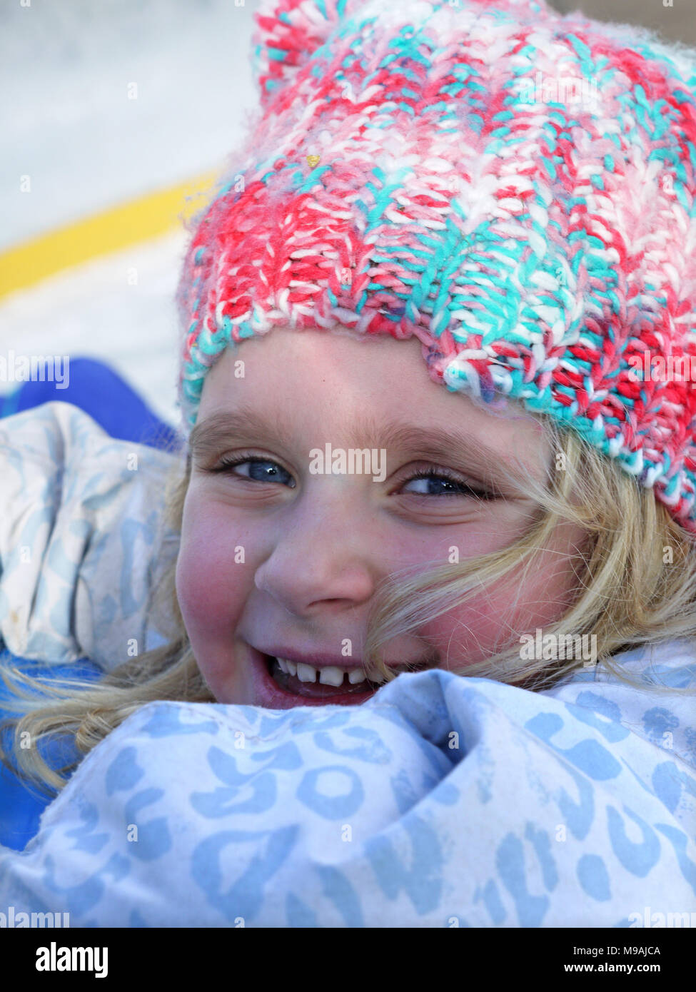 Happy young skier in the ski resort of moraine, France Stock Photo