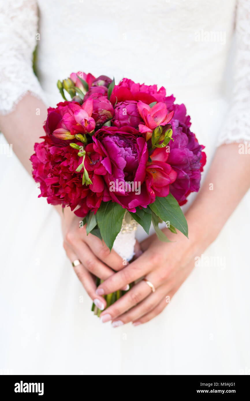 Wedding Bouquet Of Pions Bride In A White Wedding Dress Holding