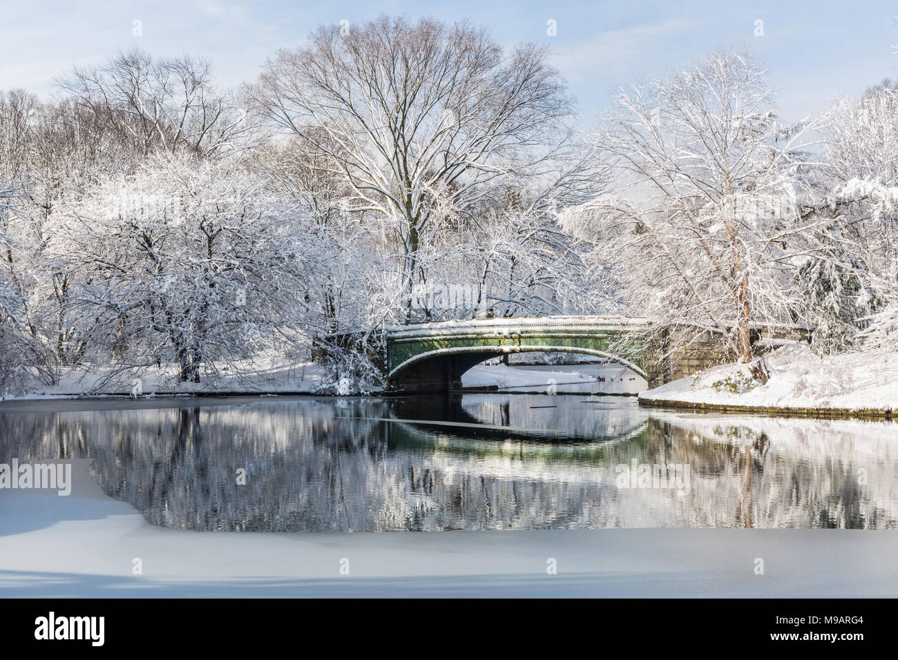 The Lullwater Bridge on Prospect Park Lake after a record SPring snowfall in Prospect Park, Brooklyn, New York. Stock Photo