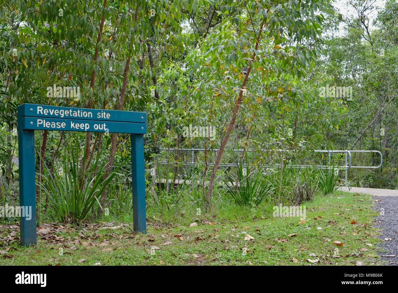 Revegetation please keep out sign, Crystal Creek QLD 4816, Paluma range national park, Australia - Stock Image