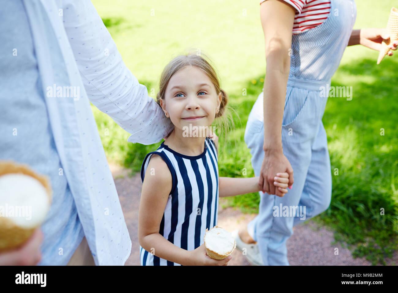 Walk with ice-cream - Stock Image