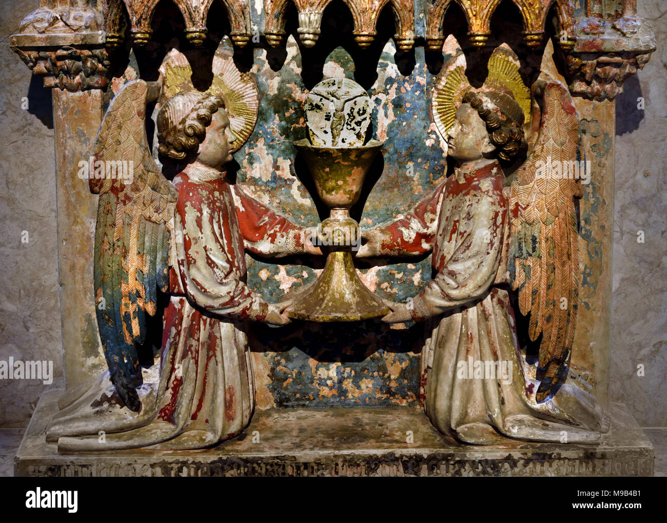 Corpus Christi Retable 1443 sculptor João Afonso, Portugal, Portuguese, Coimbra ( Corpus Christi chapel located in the center of the Jewish quarter ) relief where two kneeling  raise the Eucharistic chalice with the Host, - Stock Image