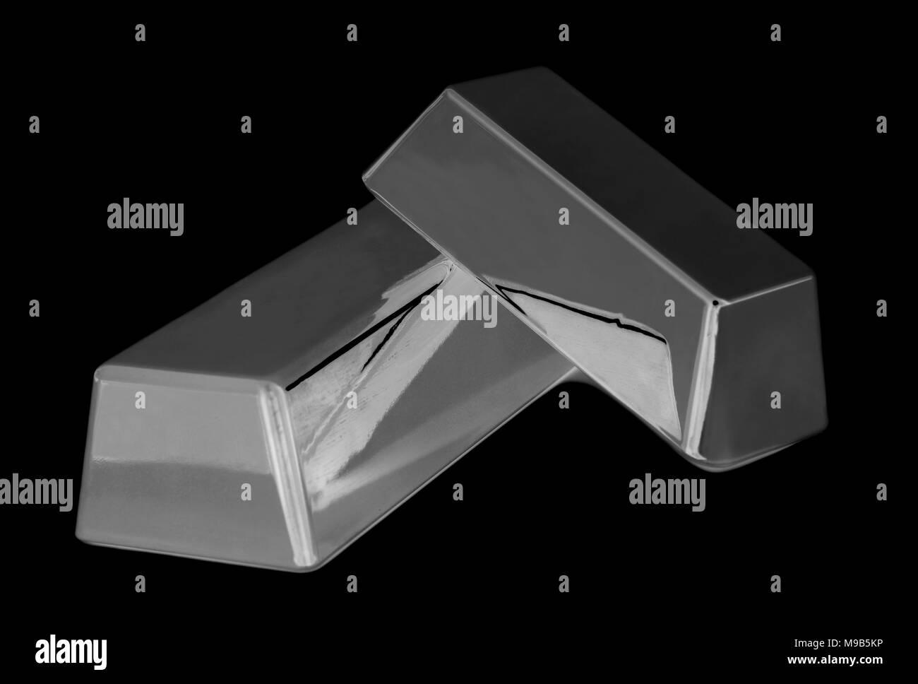 Silver bullion bars on black background - Stock Image
