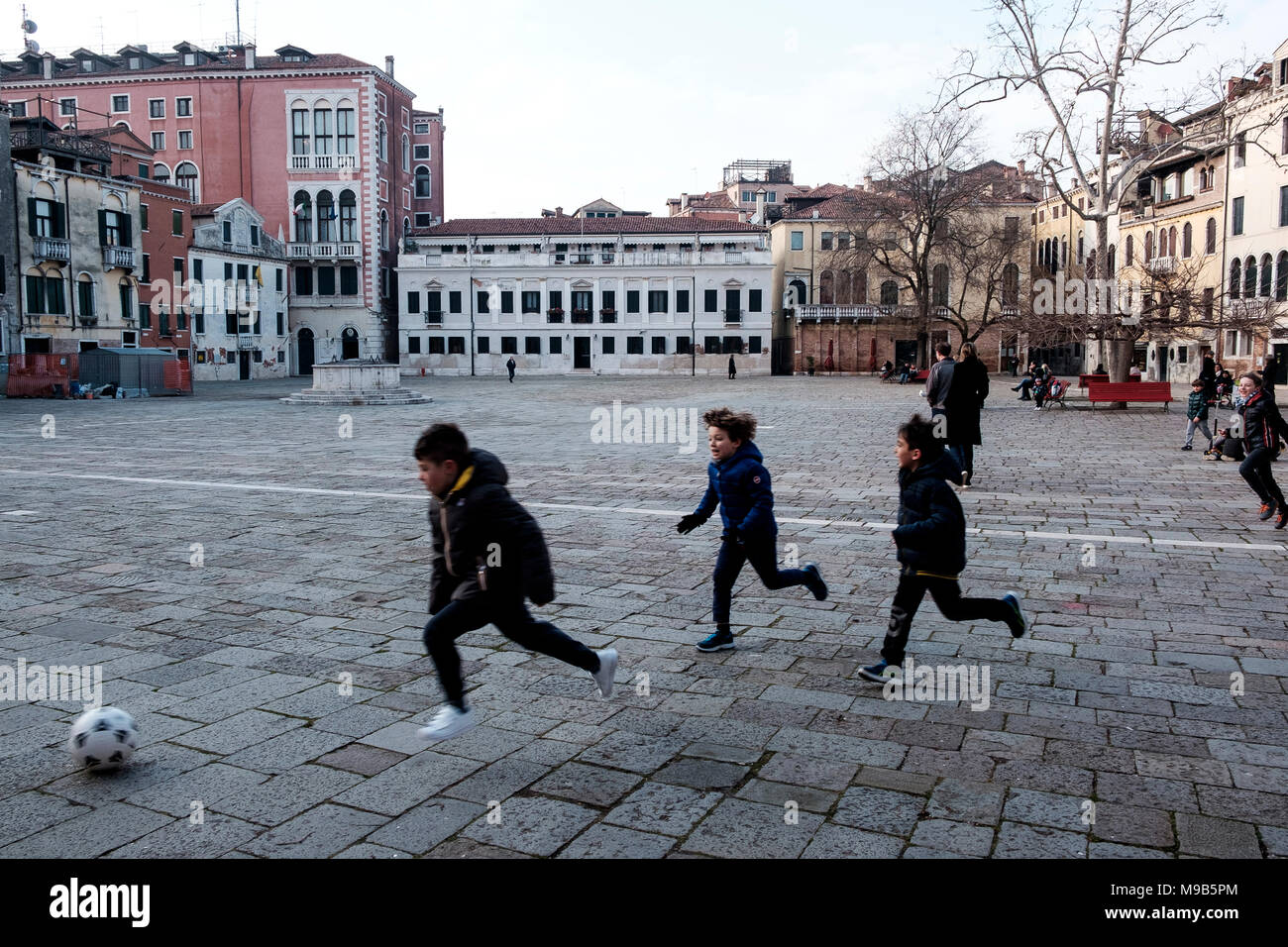Children playing football on Campo San Polo, Venice - Stock Image