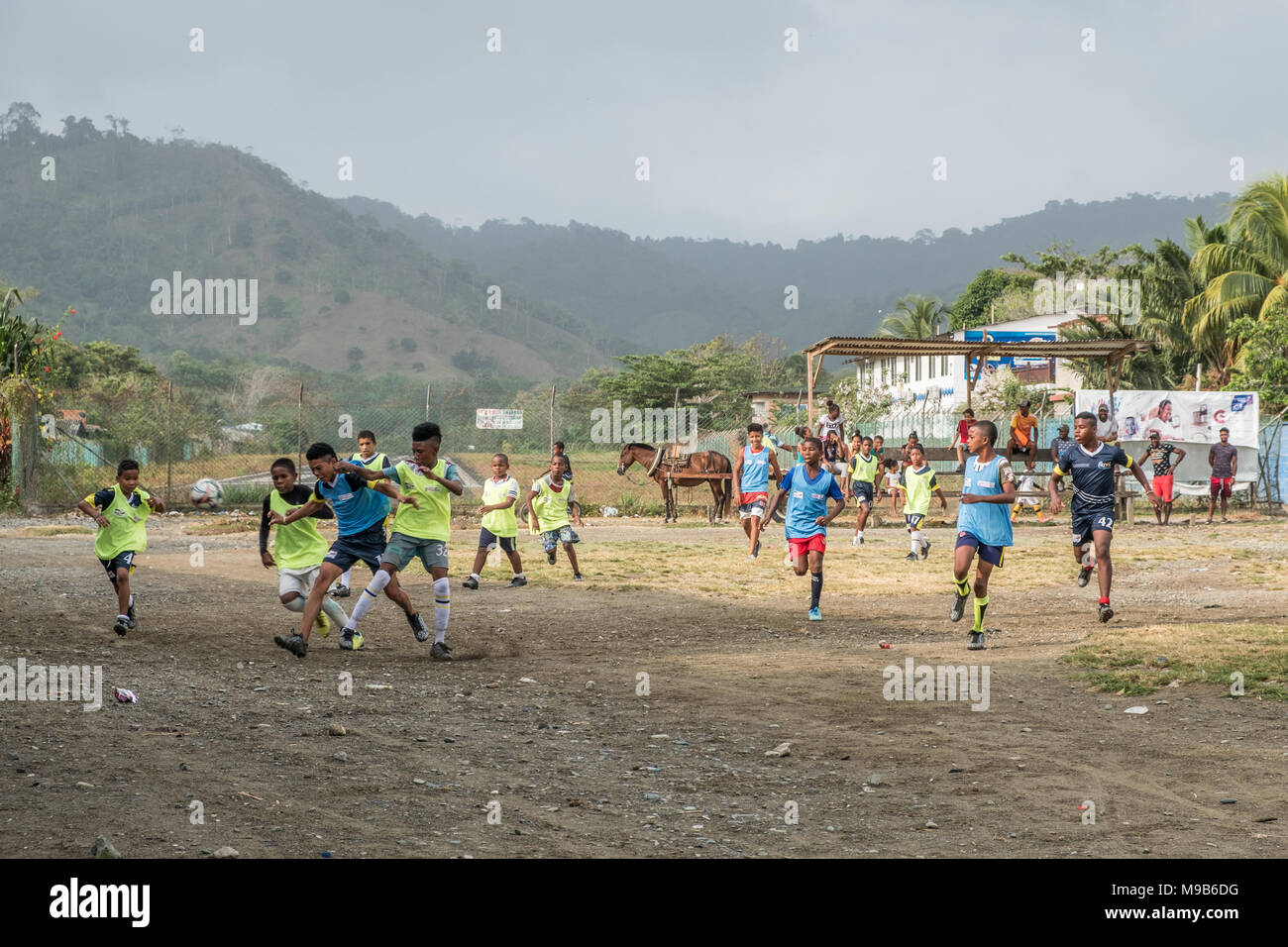 Capurgana, Colombia - march 2018: Children playing soccer on the street in village center of Capurgana, Colombia. - Stock Image