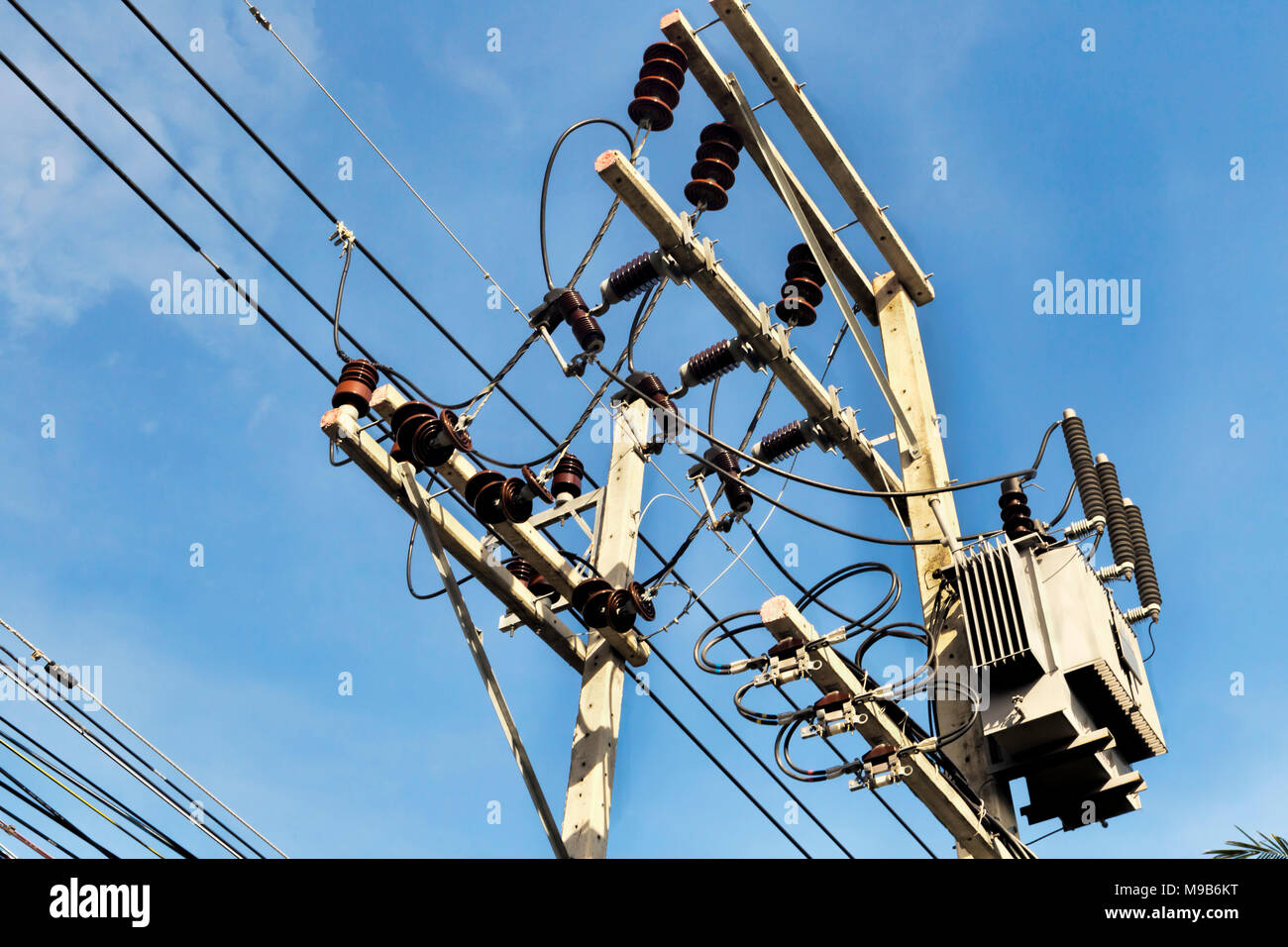 Power line piling for electricity s transport  through cables - Stock Image