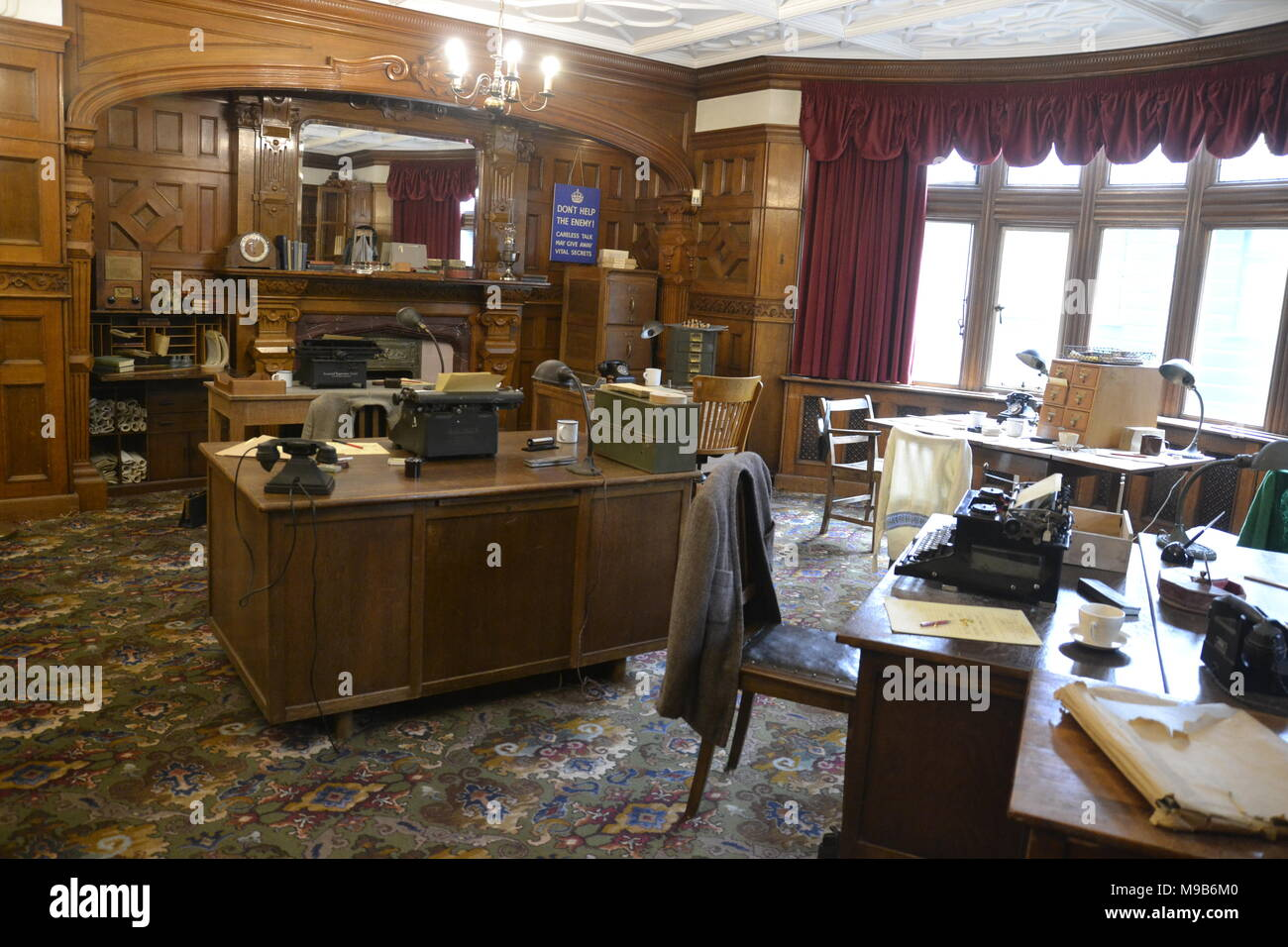 Bletchley Park. Inside the library in the manor house at Bletchley Park codebreaking offices. Typewriter, telephone. - Stock Image