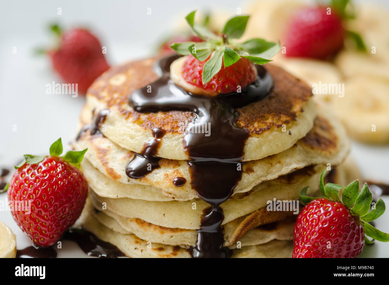 Stack of Turkish -style pancakes with Strawberry and chocolate - Stock Image