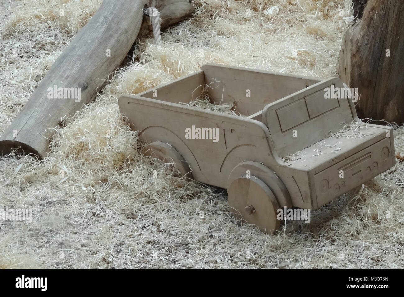 Handcrafted wooden train on an beige carpet, retro toned image - Stock Image