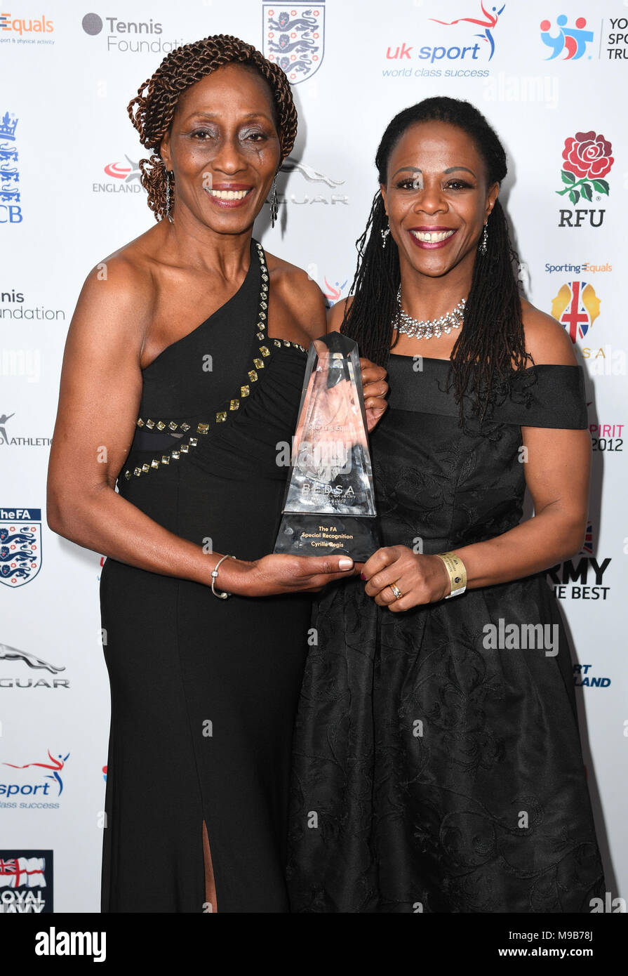 Nilla Regis (left) and Denise Regis accepting the FA Special Recognition Award for Cyrille Regis at the BEDSA Awards 2018, sponsored by Sporting Equals, at the Grosvenor House Hotel, London. Stock Photo
