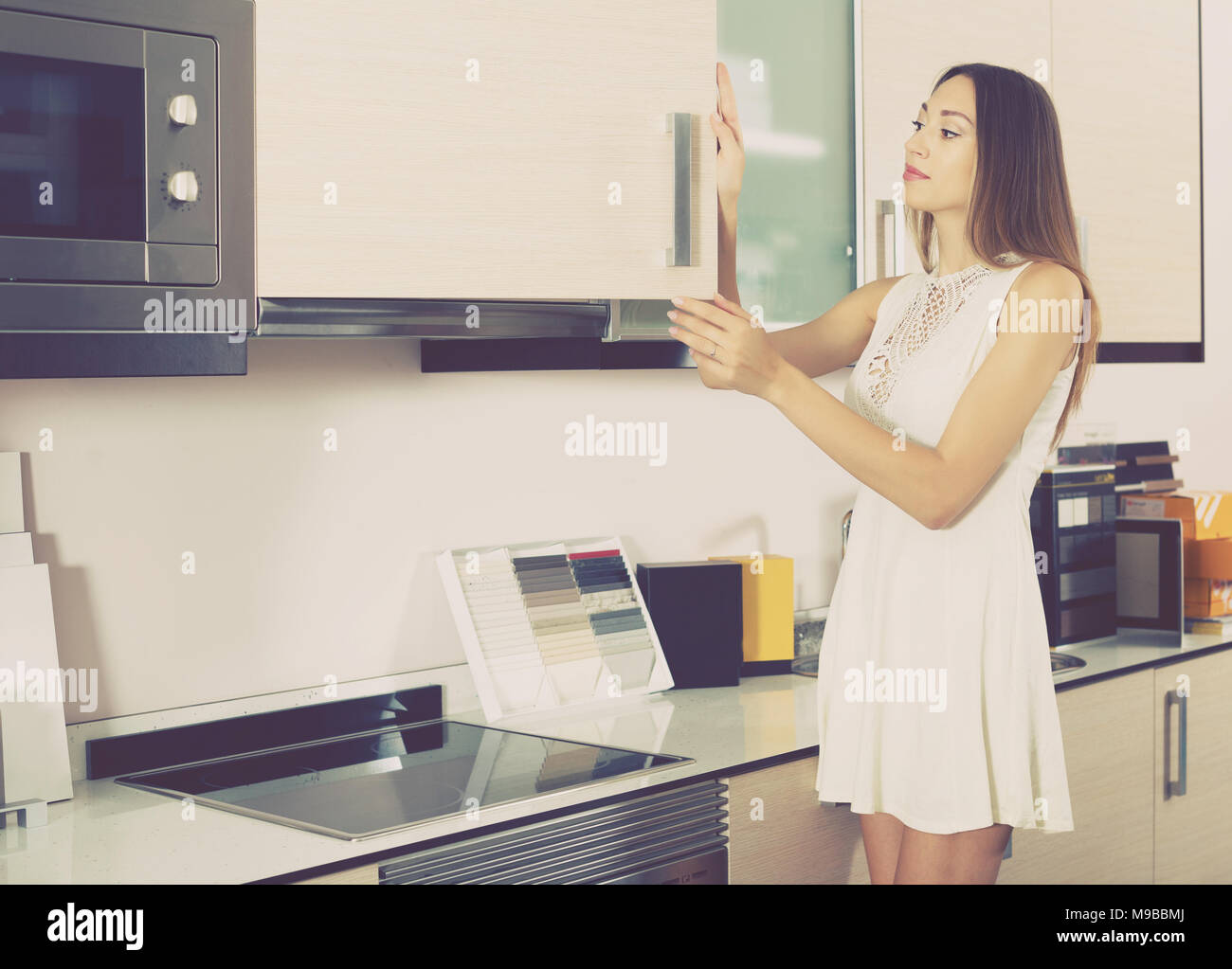 Ordinary Young Female Customers Choosing New Kitchen Furniture In