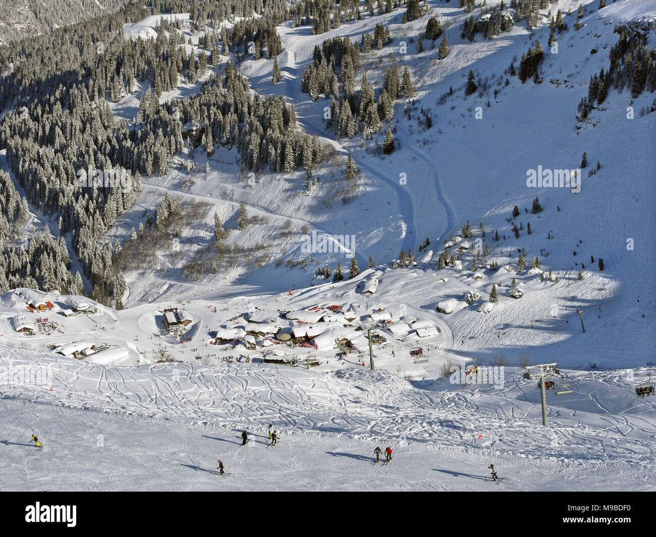 The busy ski resort of Chatel in the Portes du Soleil area of France, restaurants at Pre La Joux Stock Photo