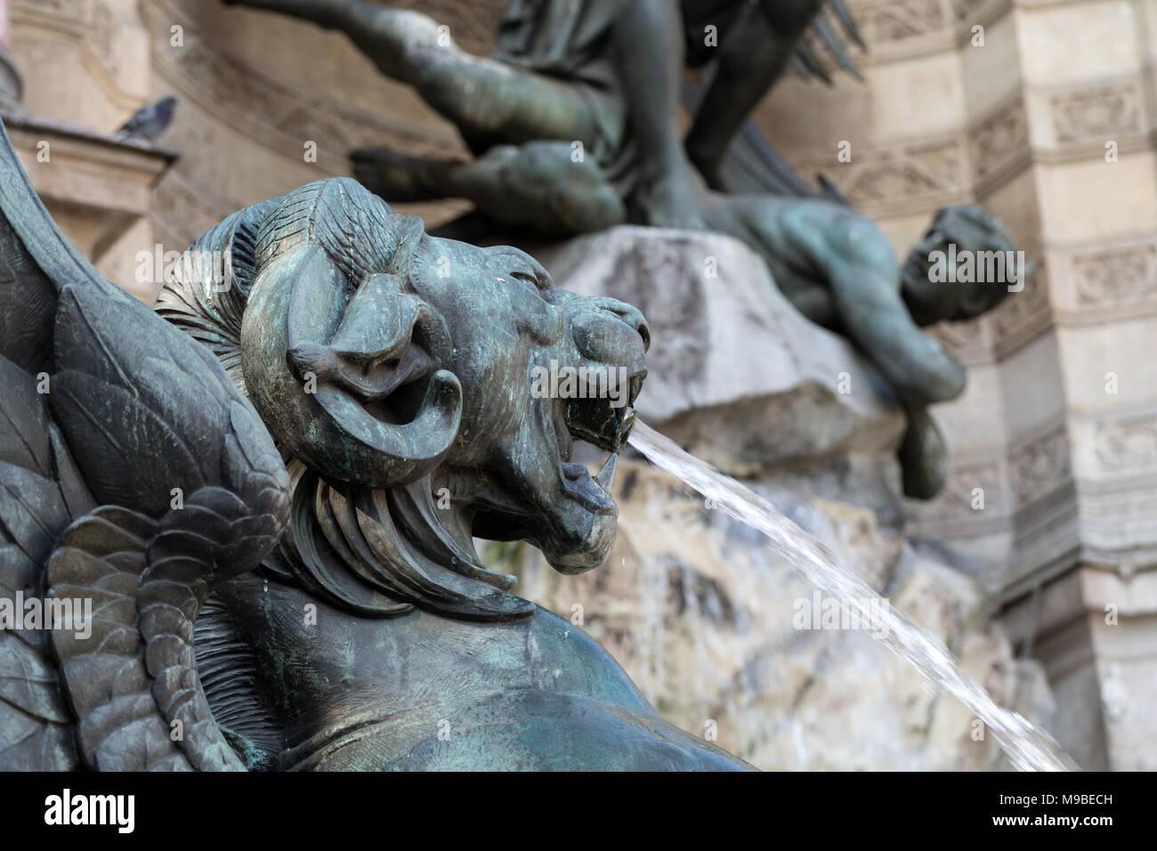 statues of Fountain Saint Michel in Paris - Stock Image
