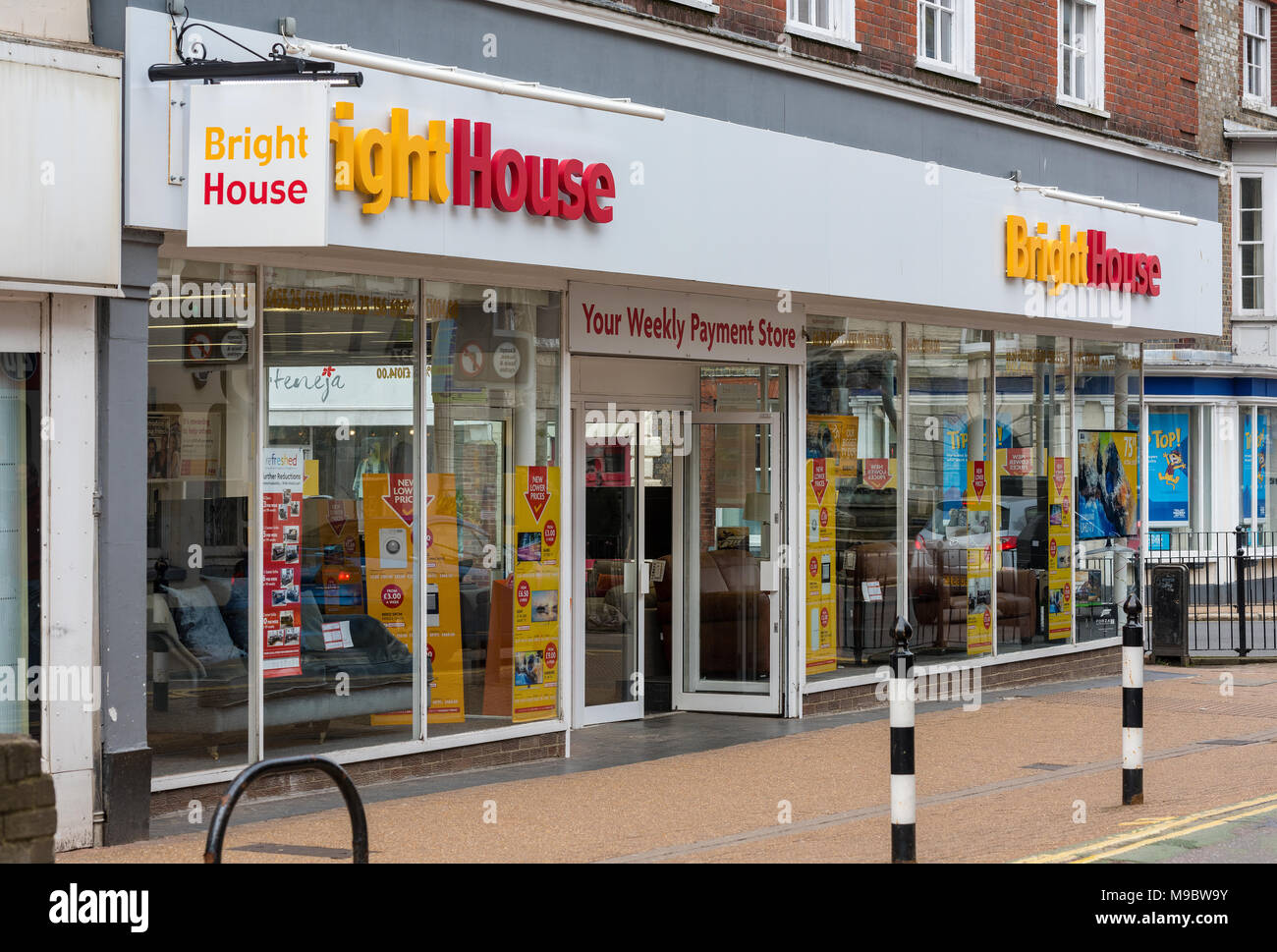 Bright house high street retailer for hire purchase on domestic appliances and white goods. High interest rates retailer in the town centre. Retailers - Stock Image