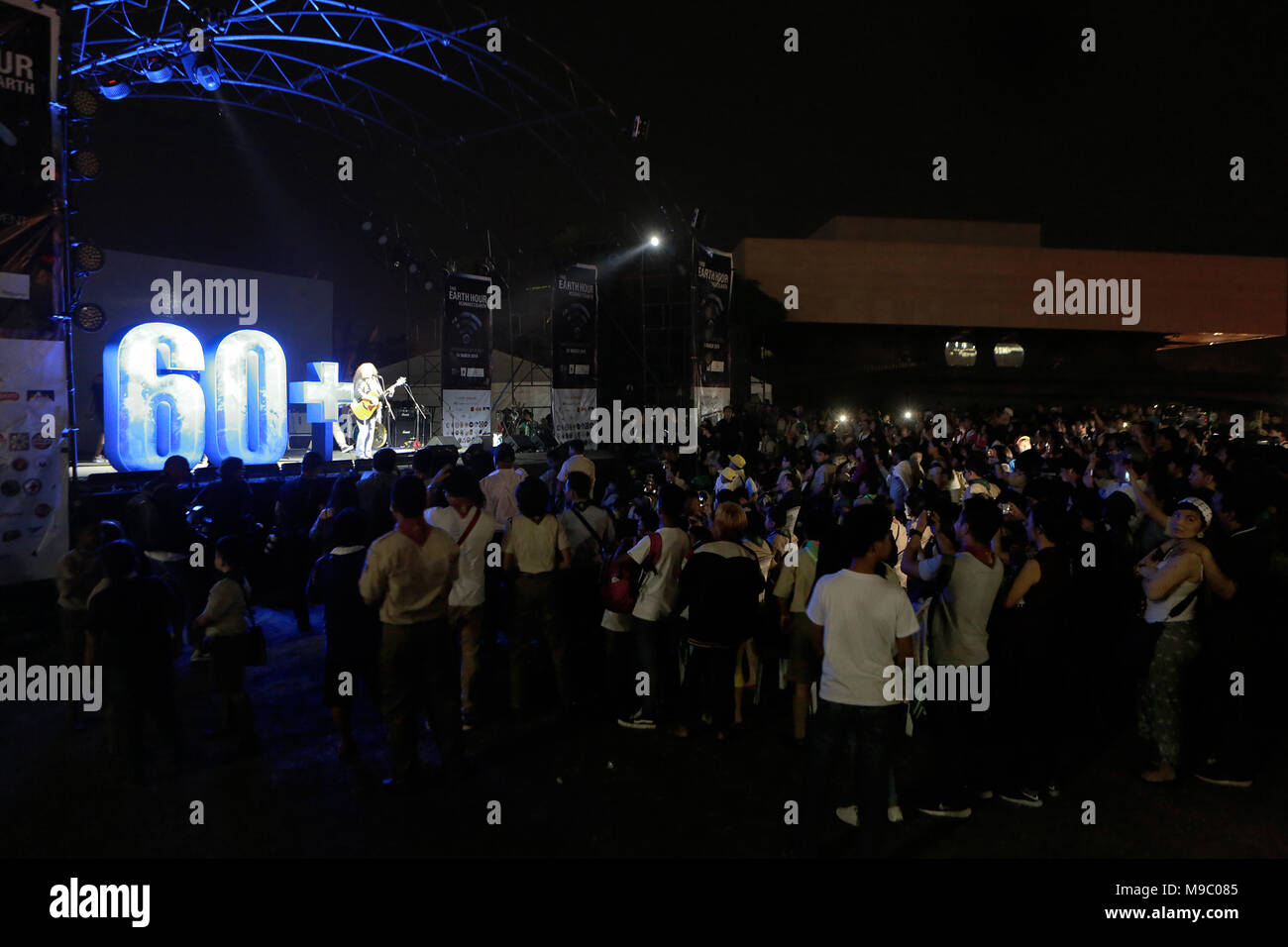 Pasay City, Philippines. 24th Mar, 2018. Artists perform during the annual Earth Hour campaign in Pasay City, the Philippines, March 24, 2018. Credit: Rouelle Umali/Xinhua/Alamy Live News - Stock Image