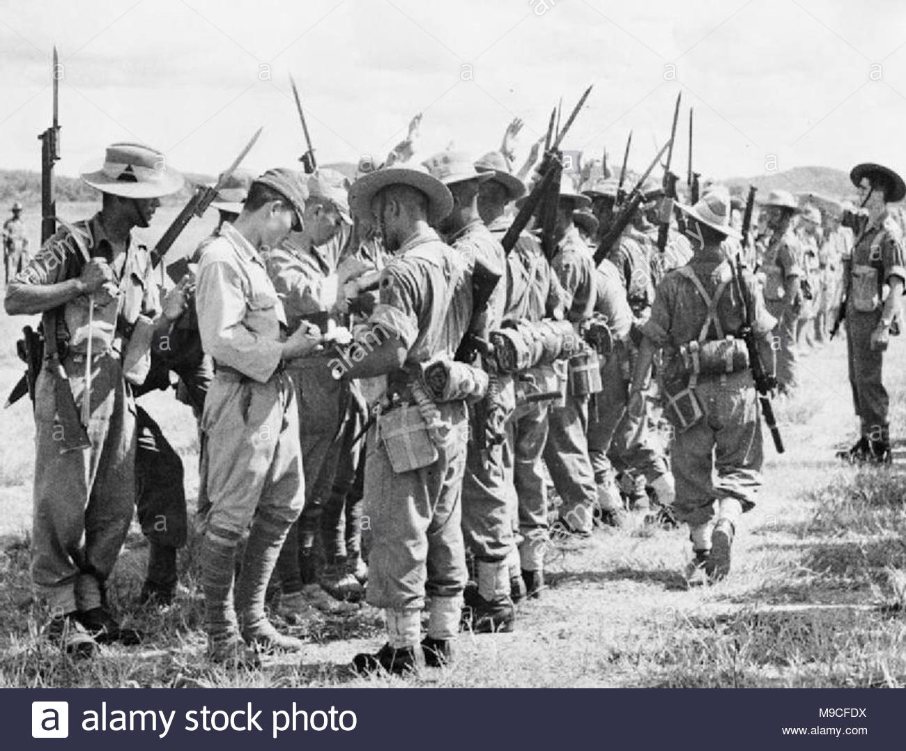 Japanese Surrender In Malaya  Men Of The Th Indian Division At Kuala Lumpur Search Japanese Prisoners Soon After They Had Been Disarmed