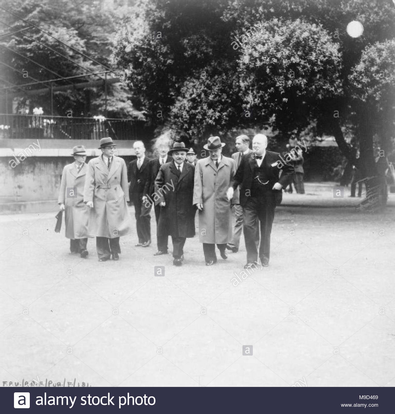 British Political Personalities 1936-1945 The Churchill Coalition Government 11 May 1940 - 23 May 1945: The Deputy Prime Minister, Clement Attlee; Secretary of State for Foreign Affairs, Anthony Eden; and the Prime Minister Winston Churchill in the garden of No 10 Downing Street with the Russian Ambassador M Maisky. - Stock Image