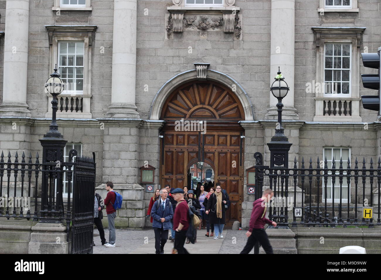 Dublin, Ireland - February 18 2018: People at Trinity College yard in Dublin, Ireland on February 18 2018 this is the largest university in Dublin and all of Ireland. - Stock Image