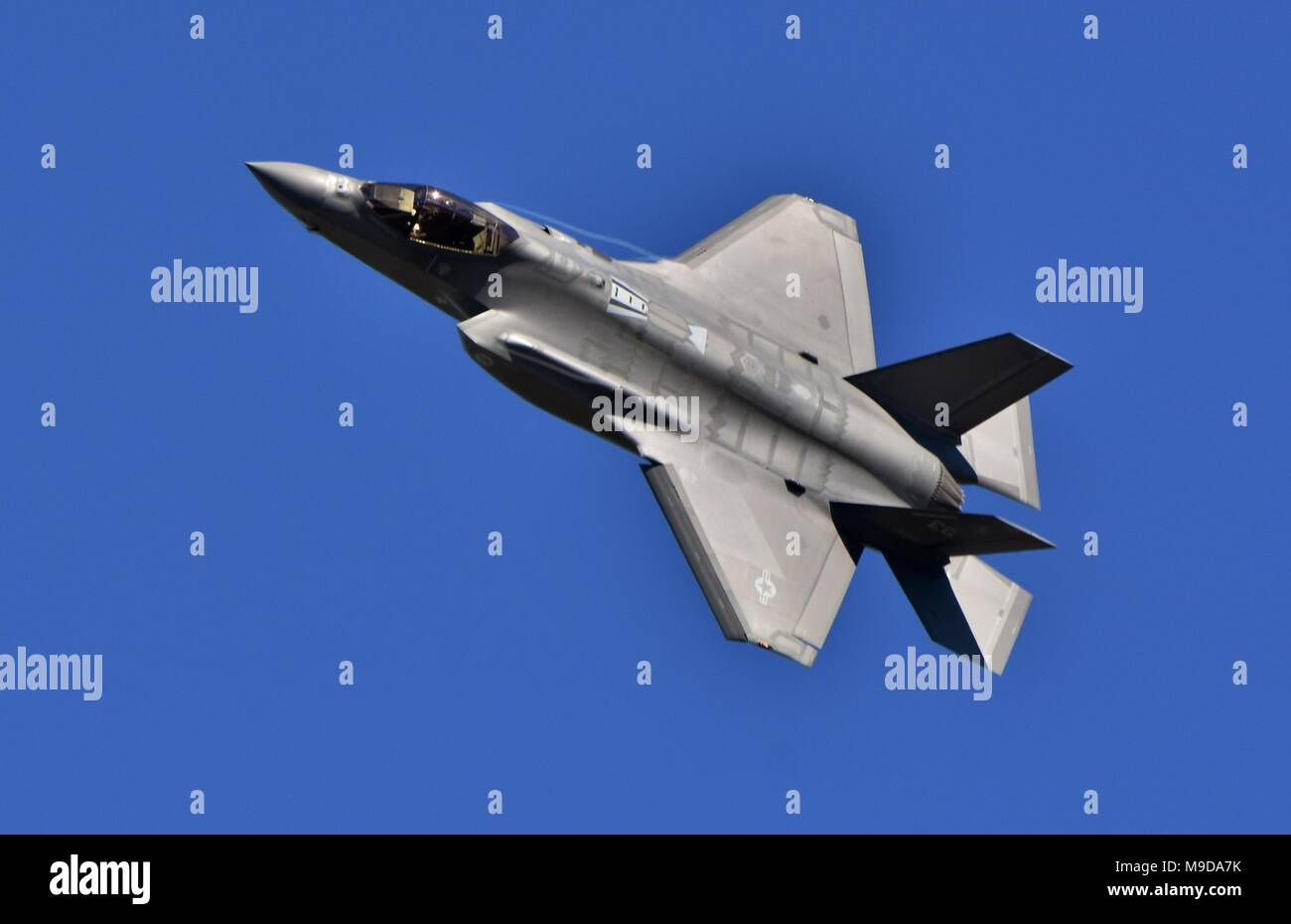 A U.S. Air Force F-35 Joint Strike Fighter (Lightning II) jet flying. This F-35 is assigned to the 33rd Fighter Wing from Eglin Air Force Base. Stock Photo