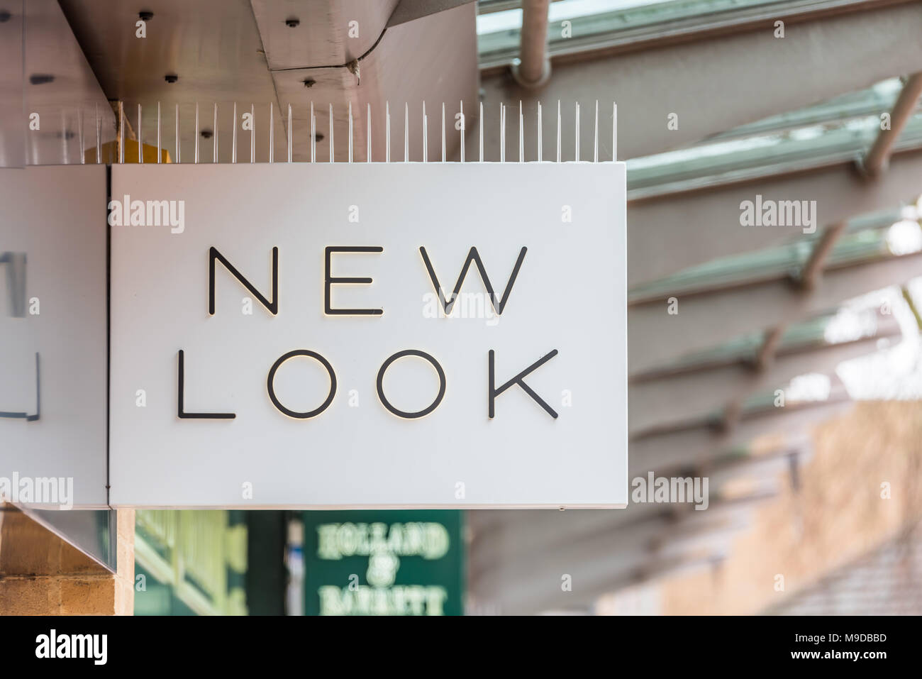 Daventry UK March 13 2018: New Look logo sign on the shopfront of retail outlet in the UK - Stock Image