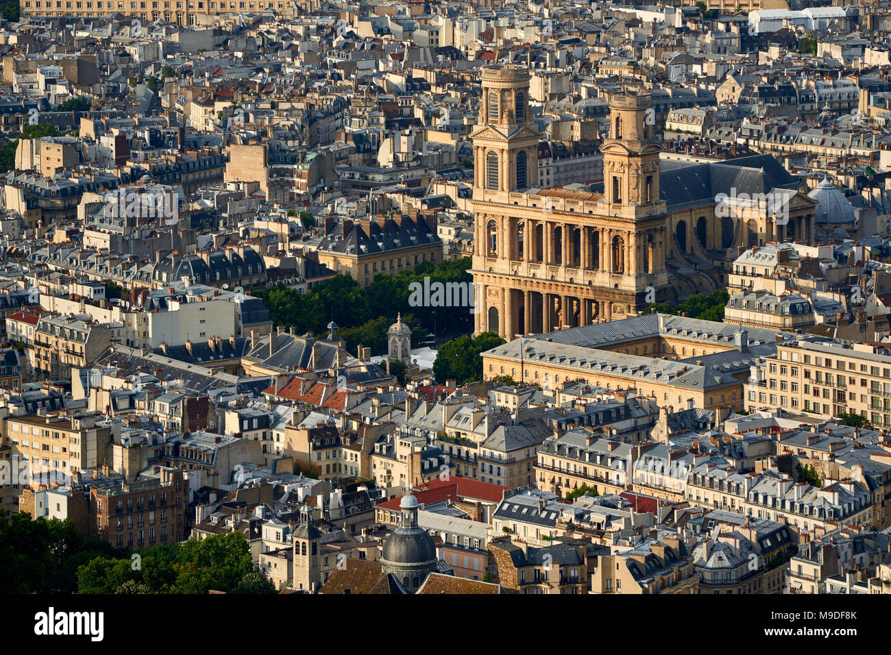 Aerial view on Saint-Sulpice Church and Paris rooftops at sunset (mansard and dormer roofs). 6th Arrondissment, Paris, France Stock Photo