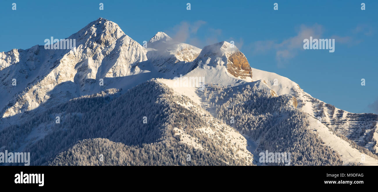 Winter in the mountains of the Champsaur in the Hautes-Alpes. Peaks of Piolit, Aiguille and Arche. Ecrins National Park, France - Stock Image