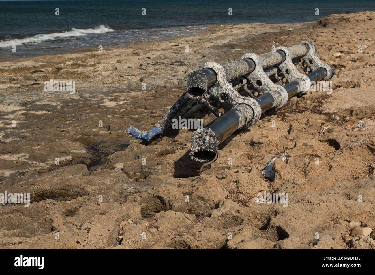 Large piece of plastic debris, environmental pollution,  covered in barnacles washed ashore on the kato paphos beach in cyprus, europe, mediterranean - Stock Image