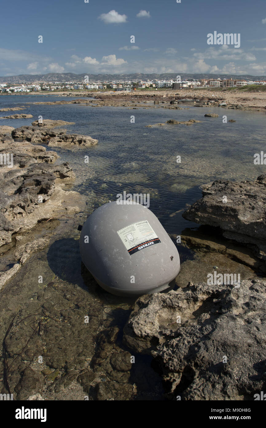 Large environmentally unfriendly plastic refuse ball on the beautiful mediterranean coast at paphos, cyprus, europe - Stock Image
