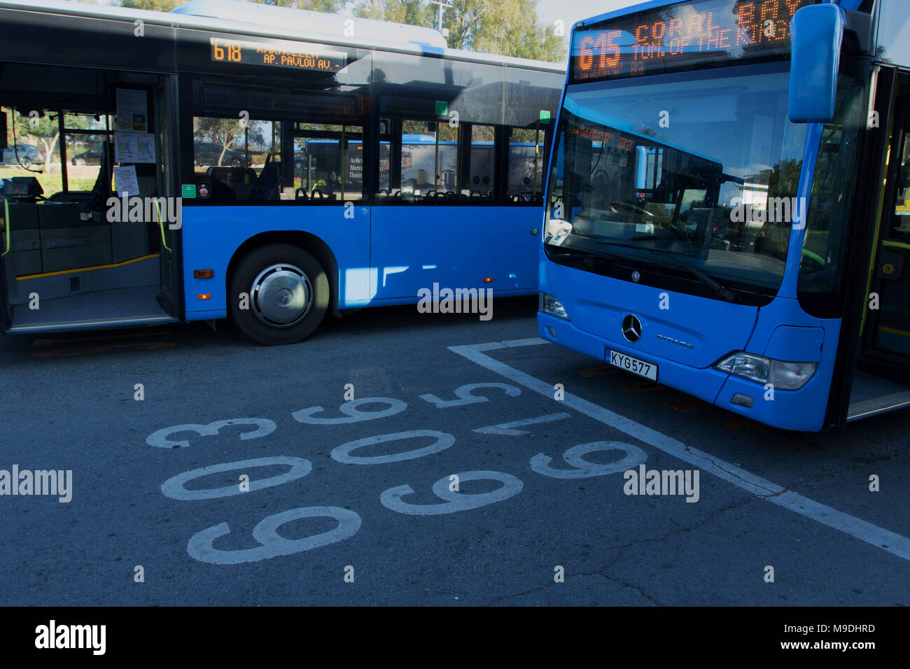 Blue paphos district busses at the kato-paphos  embarkation bus station showing route markings for local area, cyprus, mediterranean europe - Stock Image