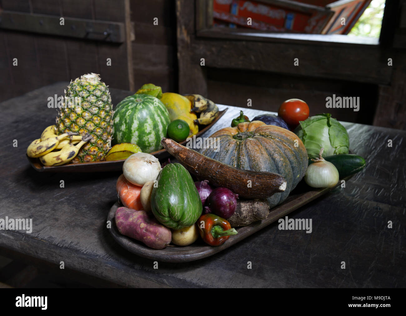 Traditional fruits and vegetables on a table in a home, Costa Rica - Stock Image