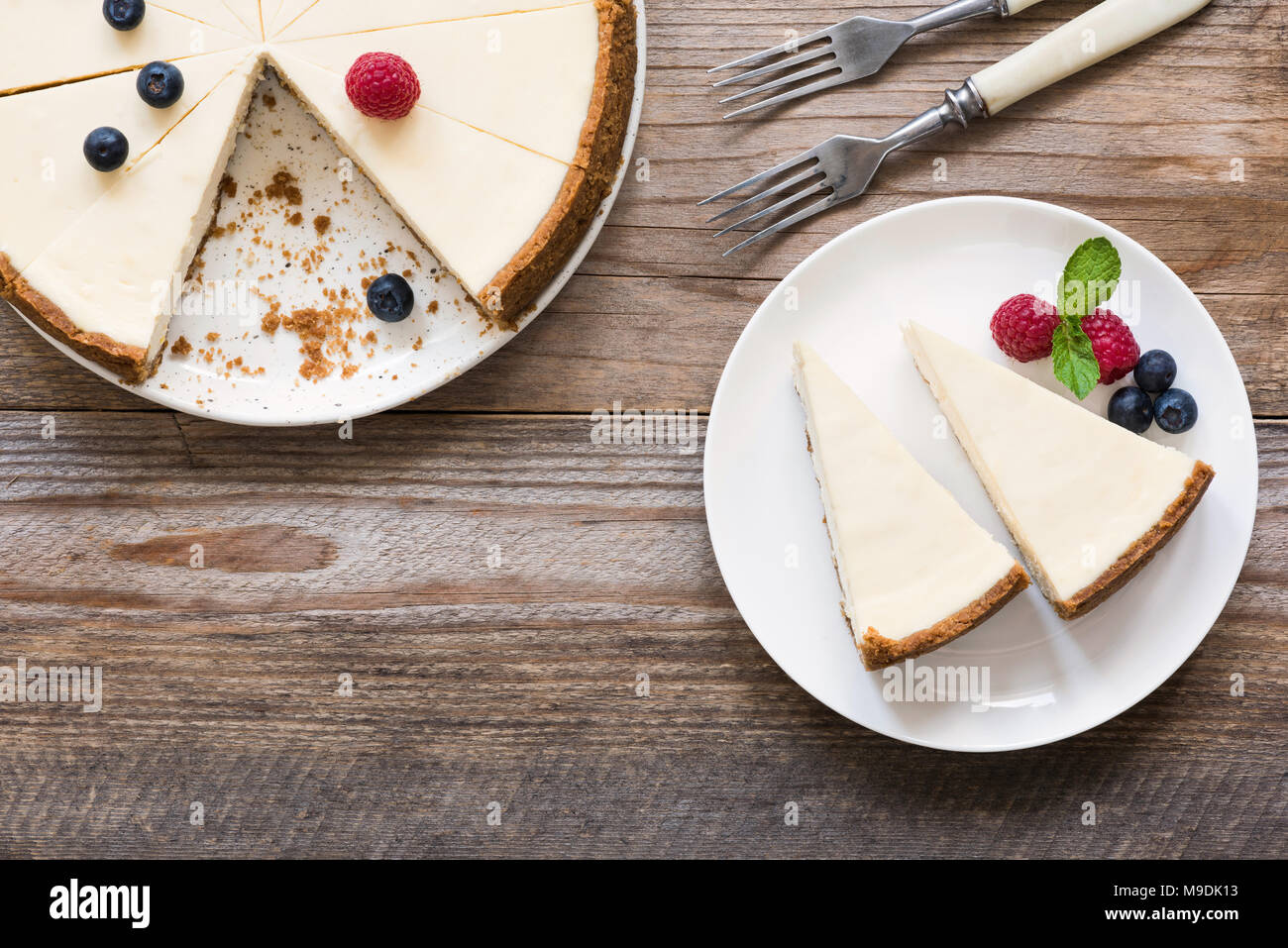 Classic New York Cheesecake On Rustic Wood, Top View and Copy Space For Text - Stock Image