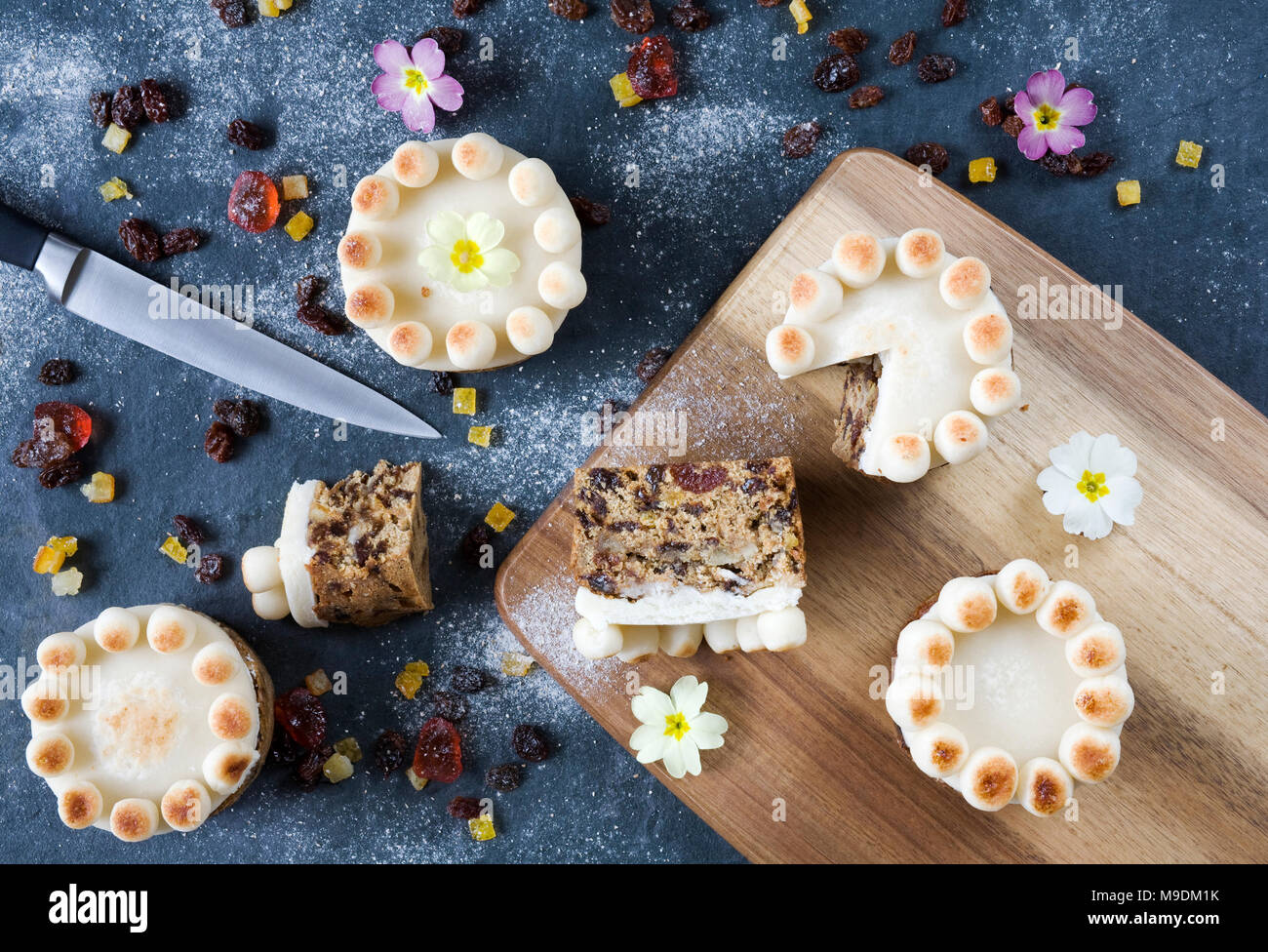 Homemade miniature simnel cakes on slate. - Stock Image