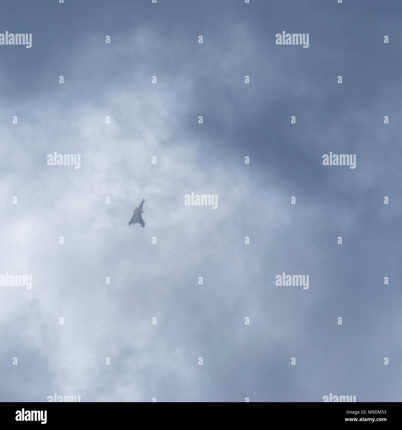 farnborough Airshow 2016: a Eurofighter Typhoon dives out from the clouds - Stock Image