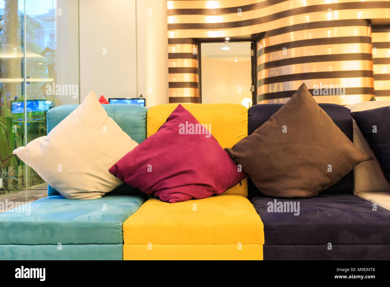 Decorative Pillows On Colorful Leather Sofa Stock Photo Alamy