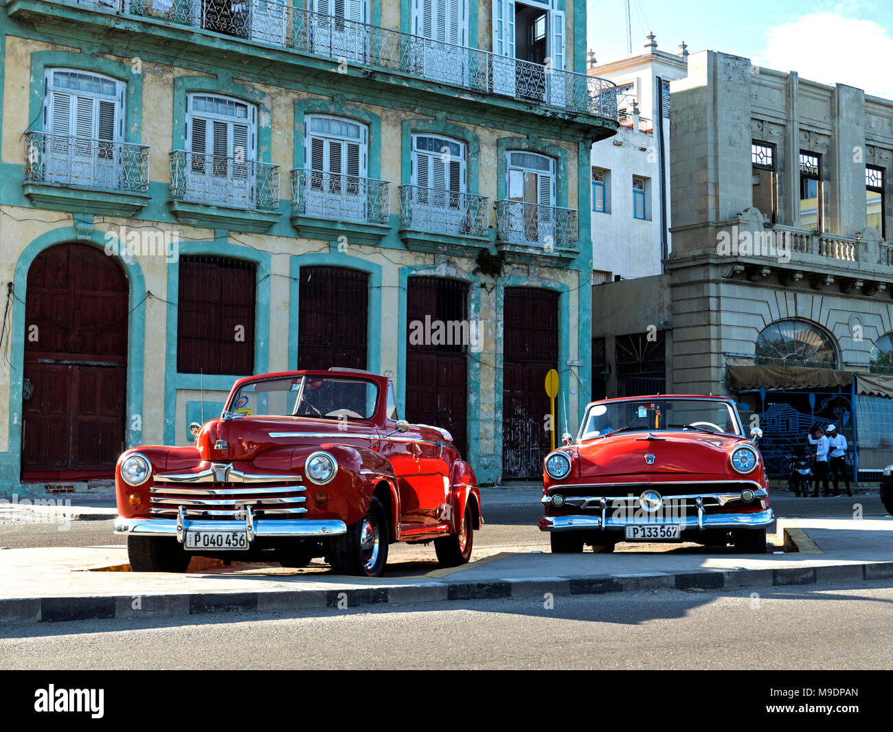 Two Vintage American Autos on Harbour Drive in front of Old Havana ...