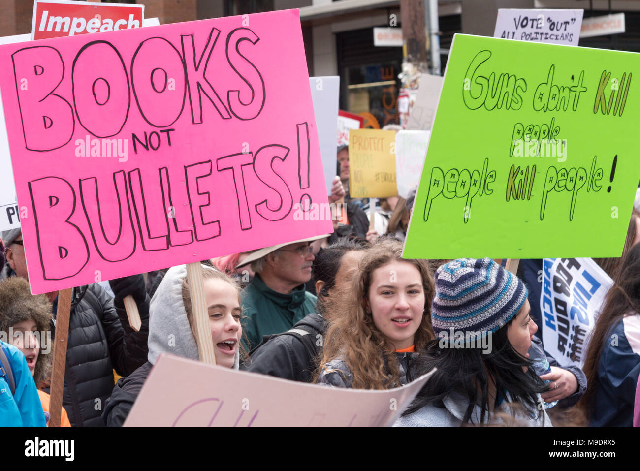 Seattle Washington, March 24th 2018 The March for our Lives rally with many students, children, youth, kids, girls holding their protest guns signs. - Stock Image