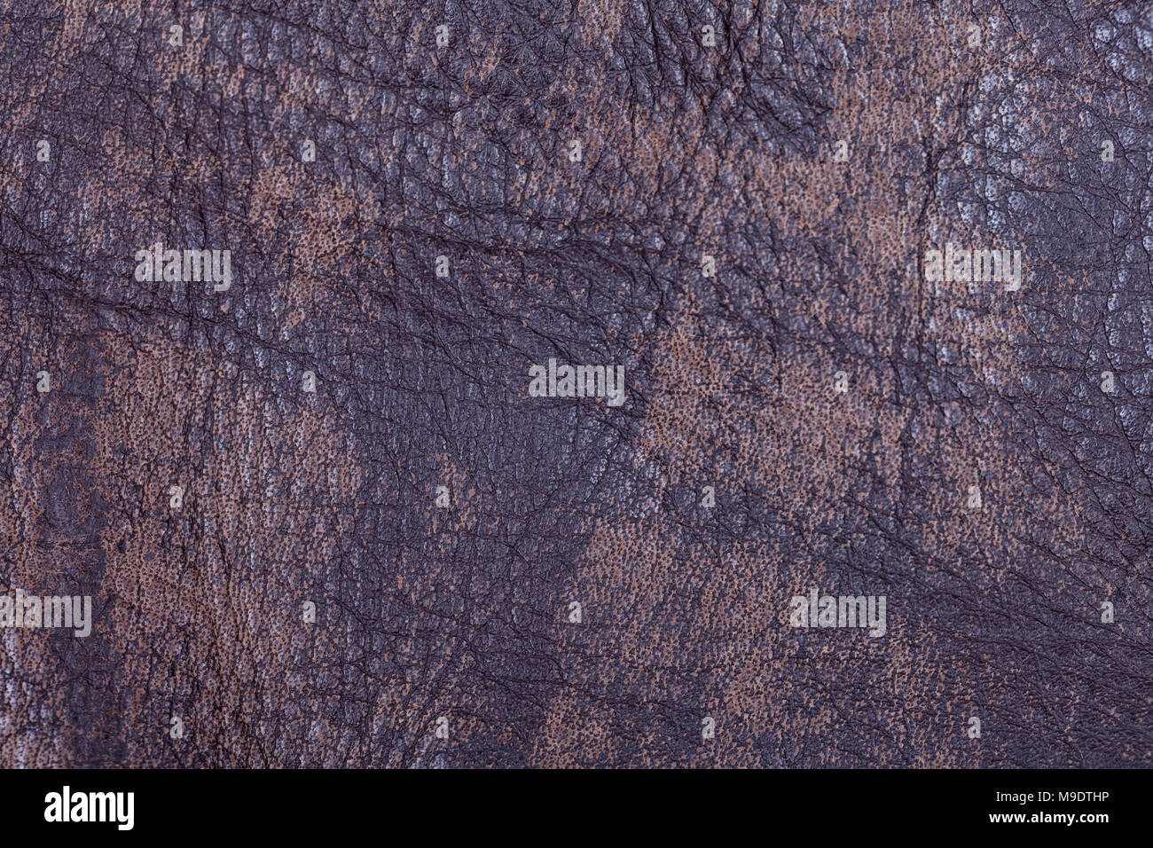 Piece of synthetic leather of brown color for the manufacture of clothes. - Stock Image