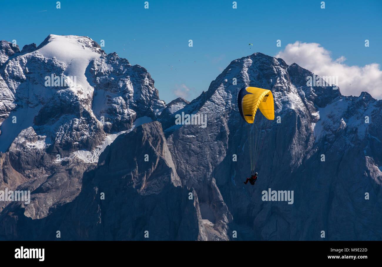 Paragliding, Dolomites, Sella Group, Sass Pordoi, Piz Boe, Fassa Valley, aerial photo, Trentino region,Italy. Mountain Top Paragliders Stock Photo