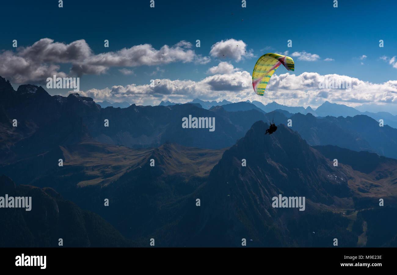 Paragliding, Dolomites, Sella Group, Sass Pordoi, Piz Boe, Fassa Valley, aerial photo, Trentino region, Canazei, Campitello, Northern Italy. Stock Photo